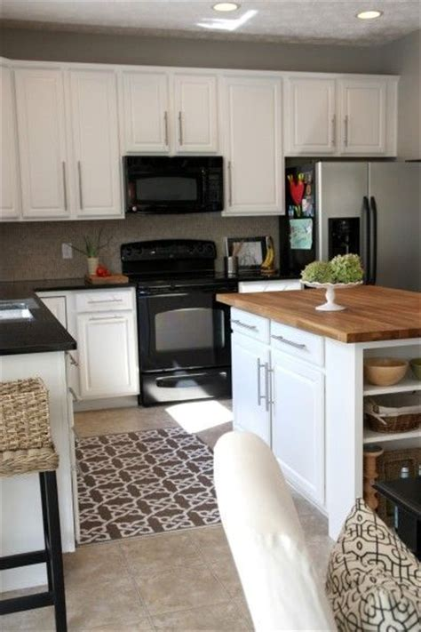 black and white appliance reno i love the combo of white cabinets black appliances and
