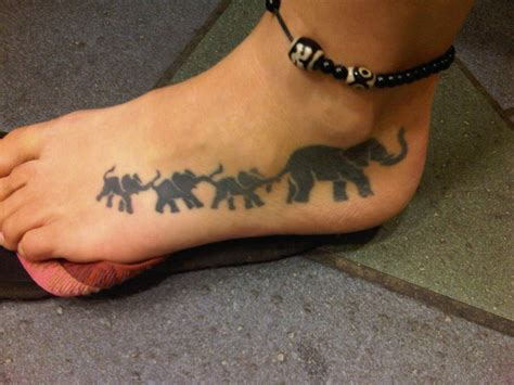 tattoo elephant chain this tattoo was inspired by the women s 3 children
