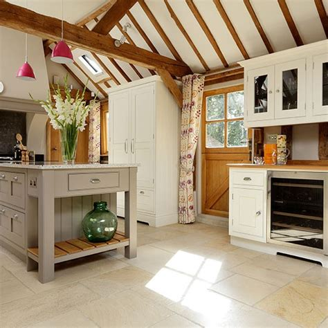 cream walls and exposed beams housetohome co uk taupe and cream painted country kitchen decorating with