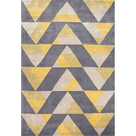 rug design a dynamic geometric design of repeating triangles gives this rug the illusion of depth and