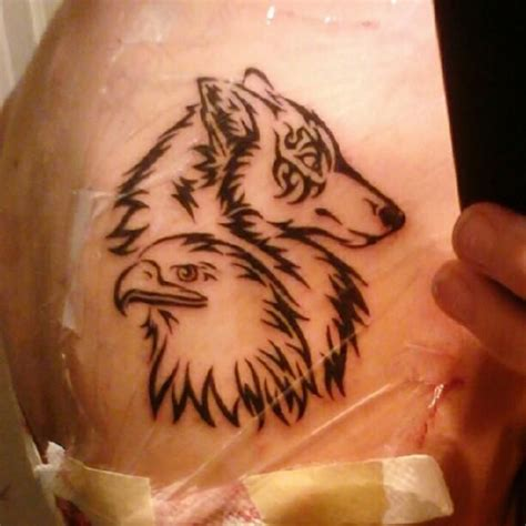 tribal mom tattoos my on my left shoulder wolf for me and eagle for
