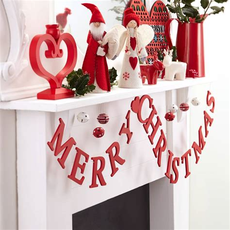 merry christmas wooden garland by the christmas home