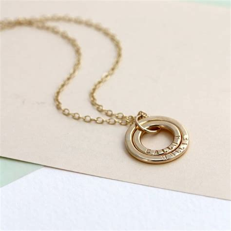 personalised 9ct gold baby names necklace by posh totty