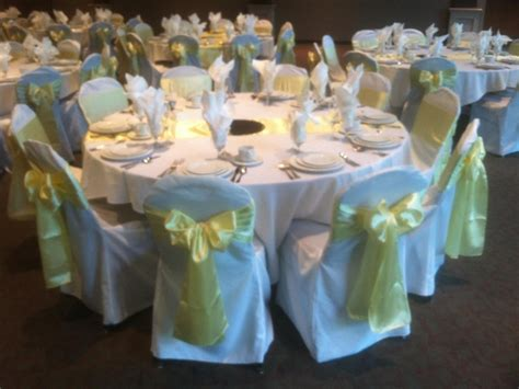 White Chair Cover Rentals For Weddings by Light Yellow Satin Sashe On White Chair Cover Wedding