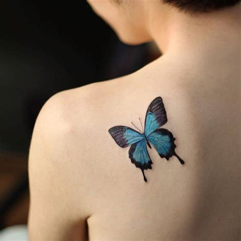 small shoulder blade tattoos small blue butterfly on the left shoulder blade