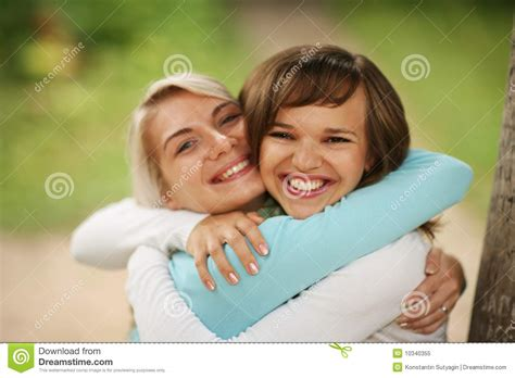 how to cuddle with a girl on the couch two girls hugging royalty free stock photo image 10340355