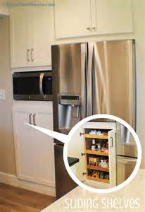 kitchen microwave pantry storage cabinet a built in microwave is located in the center of a tall