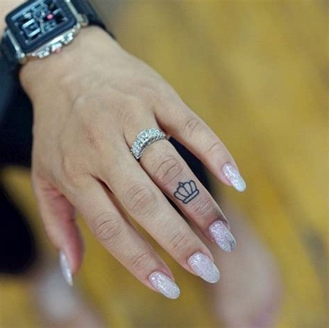 50 eye catching finger tattoos that women just can t say 50 eye catching finger tattoos that women just can t say
