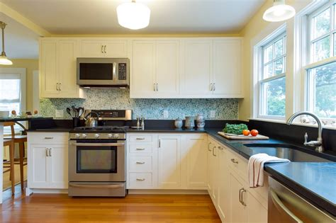 open kitchen design ideas open kitchen with ceiling beams decorative green backsplash and white cabinets with black