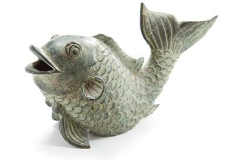 what do koi fish symbolize? | lovetoknow