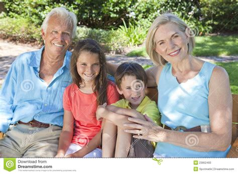 Being Grand Parents by Happy Grandparents And Children Family Outside Stock