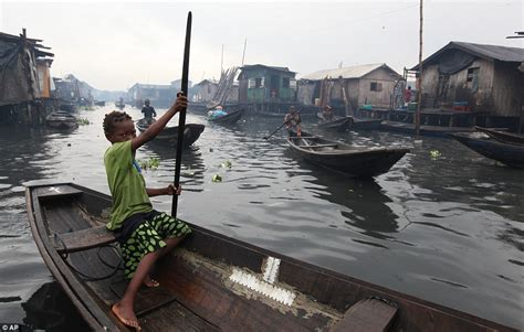 empties water from boat the world of nigeria s floating slums heartbreaking