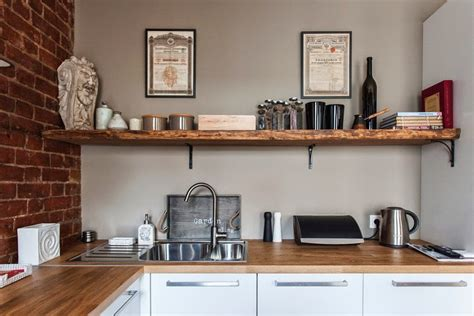 studio apartment kitchen studio apartment stays authentic by keeping its brick