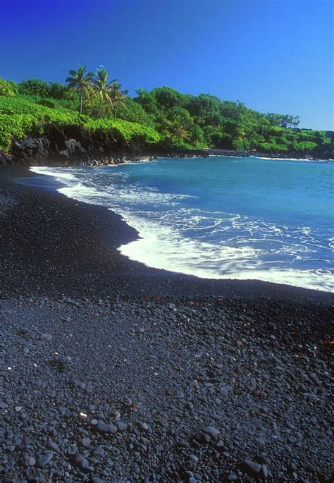 beach with black sand black sand beach hana maui hawaii print by john burk