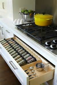 kitchen with spice rack drawer below gas cooktop well