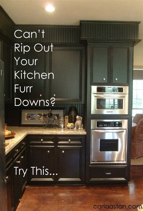 decorating ideas for soffit above kitchen cabinets