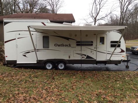 outback toy hauler travel trailer rv sales 2 floorplans keystone outback 27 l rvs for sale