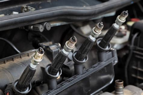 change  spark plugs steps pictures digital trends