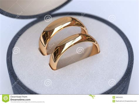 of gold wedding rings in jewelry blue box stock