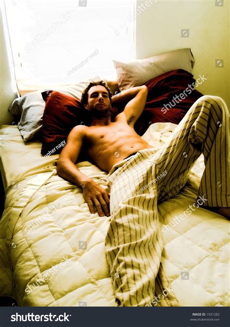 lay on the bed man laying on bed soft focus stock photo 1931282