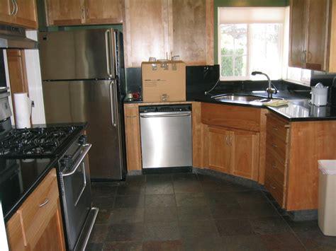 Small Kitchen Makeover Design With Black Pearl Granite Countertops With Corner Cherry Cabinets Ideas