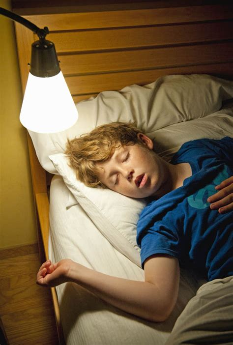 lit co sleeping scared children allowed by half of parents to sleep with
