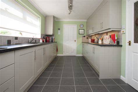 Floor And Decor Arlington bespoke mint green and light grey painted kitchen
