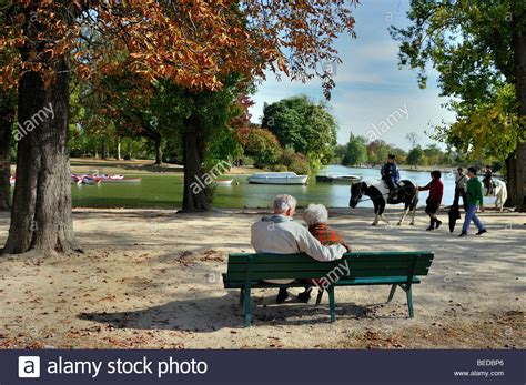 behind the bench paris france senior couple sitting on park bench from