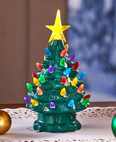 table top christmas tree in pleiglass with falling snow retro ceramic tabletop trees the lakeside collection