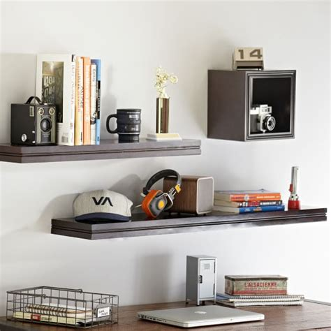 office gaming room with wall to wall shelving and couch wall to wall shelving pbteen