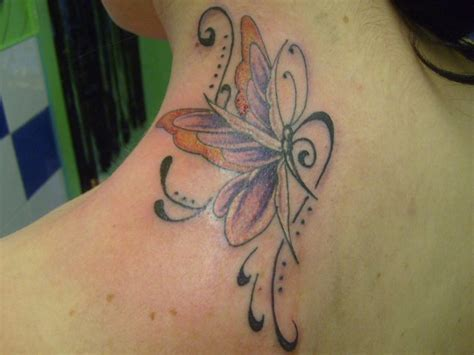 tattoo on upper neck a butterfly on the upper back neck by inkwell tattoos on