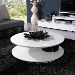 Modern white and black round coffee table in nice livingroom