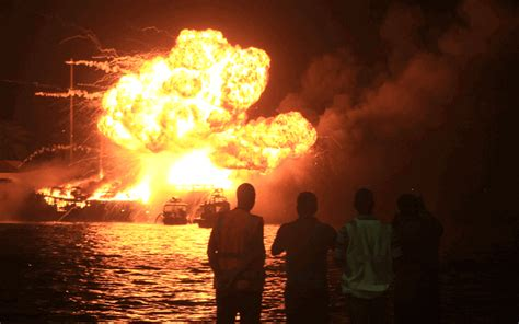 girl boat explosion dubai creek fire refuses to die down after explosions from
