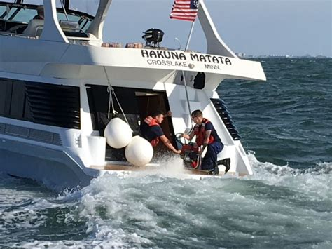 tow boat us nj coast guard rescues two in sinking boat off cape may