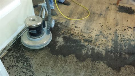 The easy way to remove old black tar linoleum adhesive