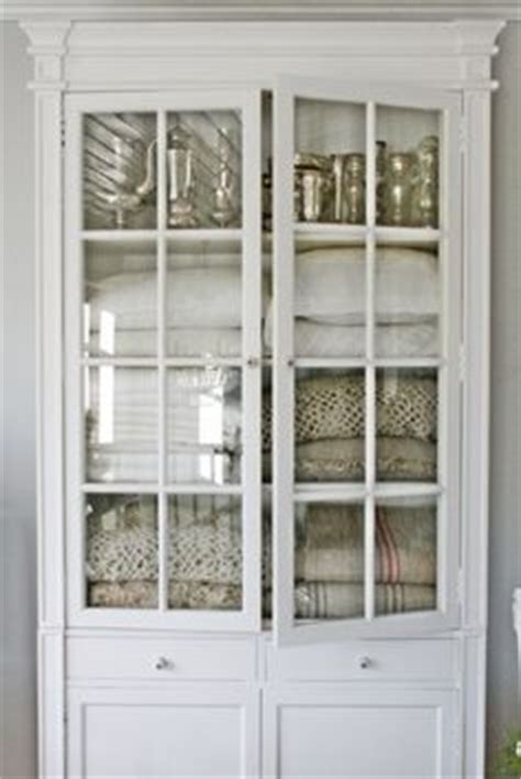 linen cabinet with glass doors 1000 images about linen cupboards on