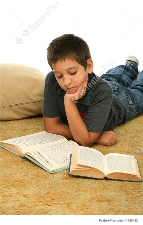 Floor Plan Creator boy reading books on the floor picture