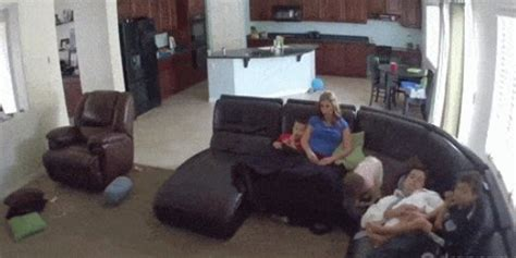 baby fell off couch dad instincts are the best gif captures sleeping dad s