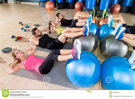 fitball crunch training group core fitness  gym stock photo image  gymnasium crunch