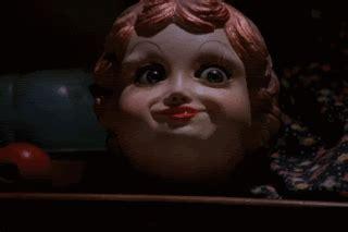 haunted doll blinks creepy doll blinks horror gif