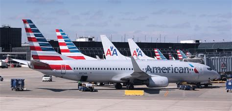 american checked bag fee credit cards that get you free checked baggage