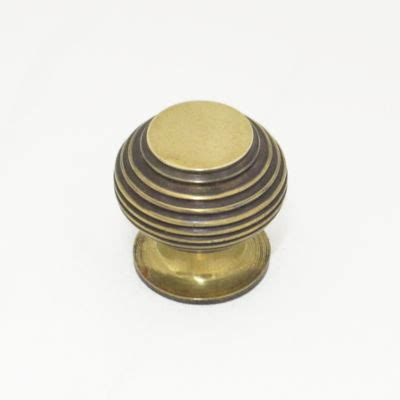 small aged brass beehive cupboard knobs