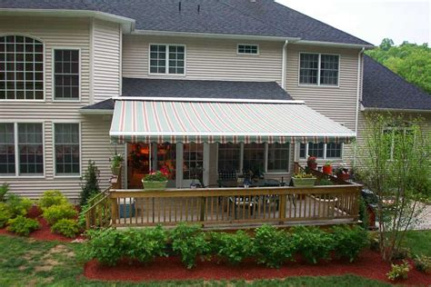 retracting awning retractable awnings all about gutters and awnings