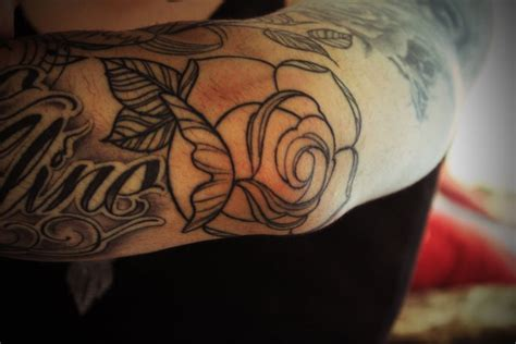 rose tattoo on elbow meaning black ink spider web on right