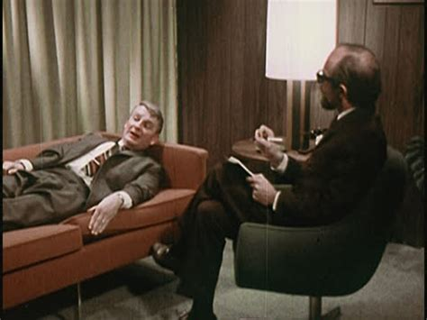 patient couch 1969 psychiatrist taking notes while patient lying on