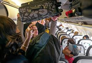 united airline carry on the best way to pack and place a bag in an overhead bin