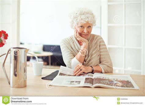 old and stylish stylish old lady at home reading stock image image of