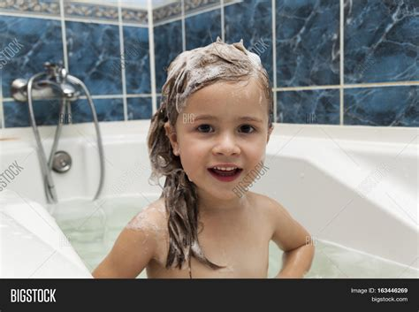 kids bathtub for shower cute little girl washes her hair image photo bigstock