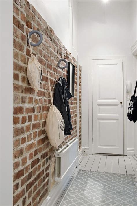 delightful Under The Stairs Bathroom Ideas #1: 12-brick-walls-are-great-for-attaching-various-hooks-and-holders-so-its-a-functional-solution-for-an-entryway.jpg