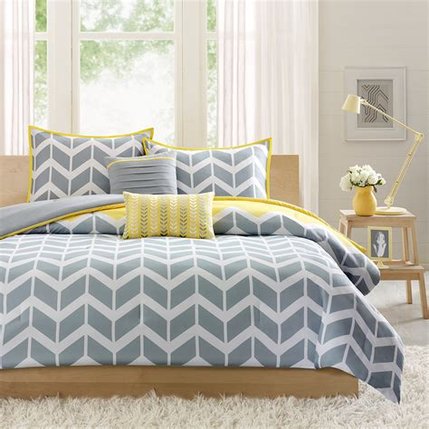 bedroom with gray bedding yellow and gray chevron bedding